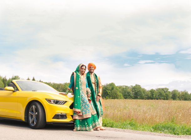 Indian couple with yellow Ford Mustang.