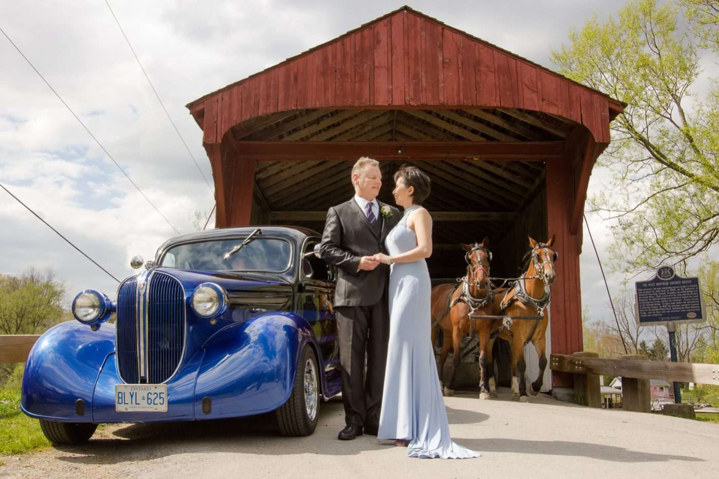 "Antique Chevy and Horse-drawn carriage at the Covered ""Kissing Bridge"" near Elmira and Elora in Ontario. Wedding photography."