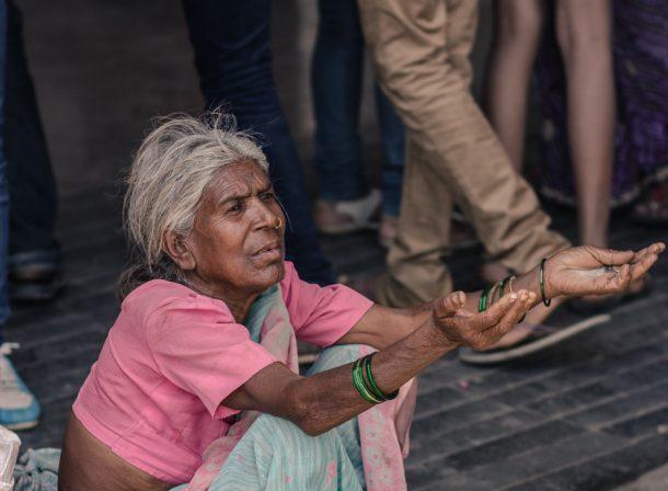 Woman begging in Mumbai, India.