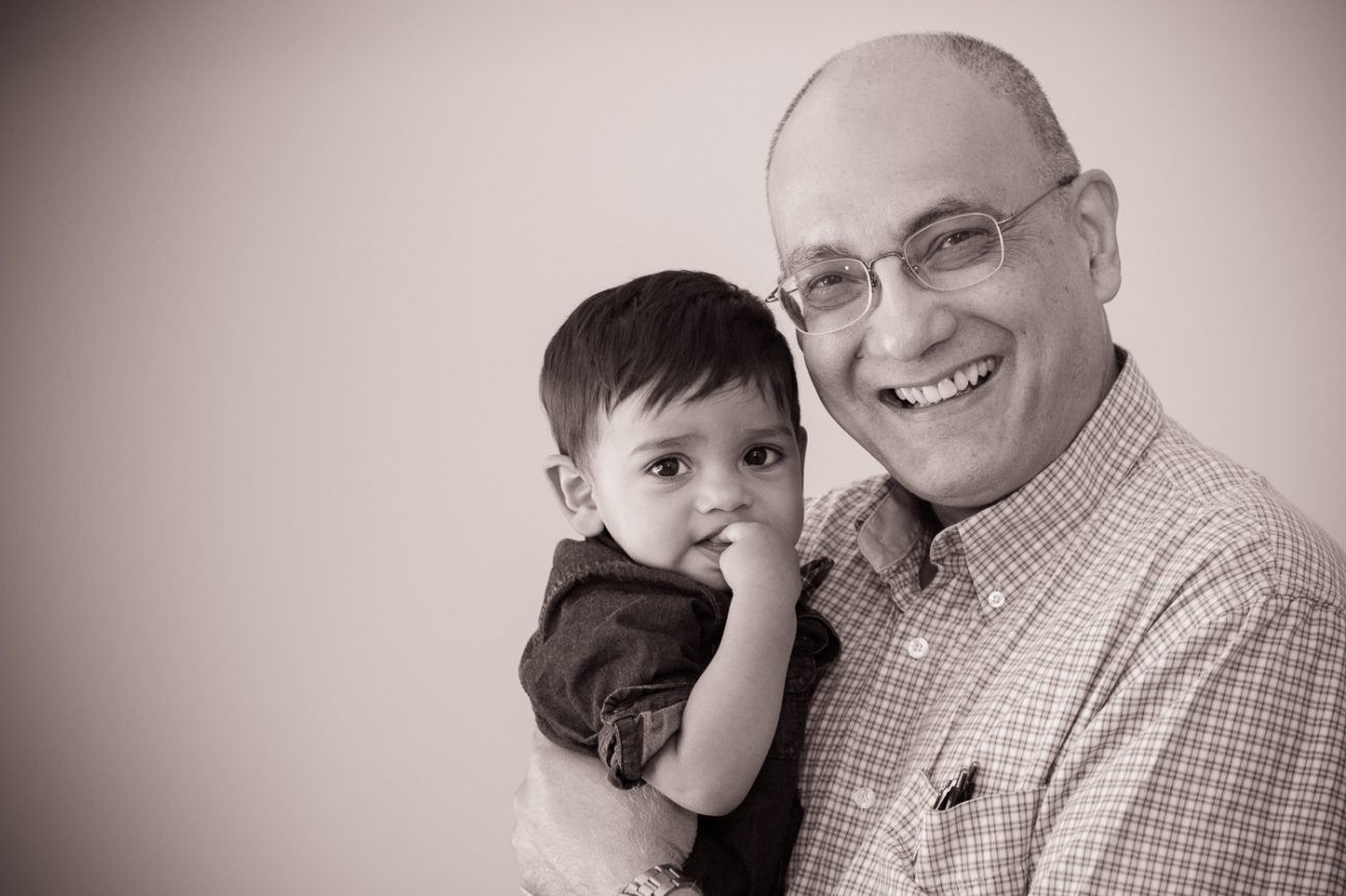 Grandfather and grandson smiling in antique light.
