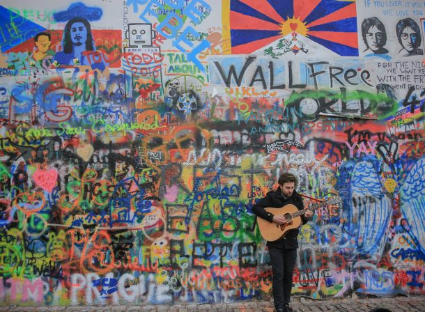 Street photography at John Lennon Wall in Prague, Czech Republic.
