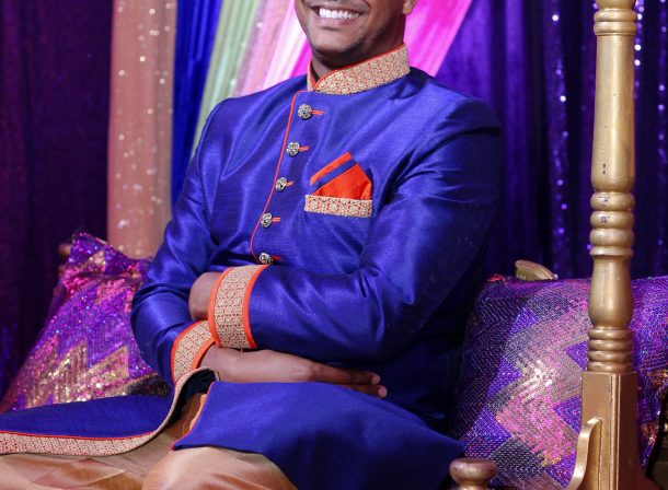 Excited Groom in blue and gold sherwani.