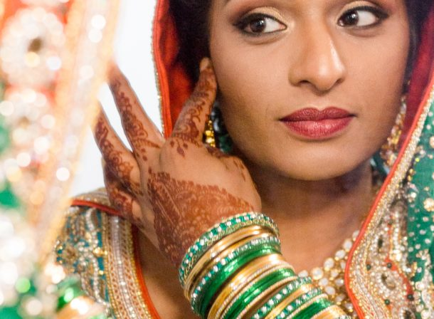 Indian Bride Getting Ready details looking in mirror