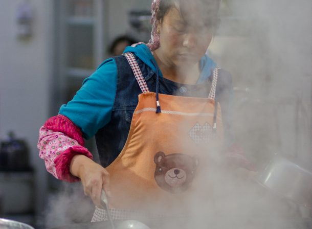 Street food maker cooking in Xi'an.