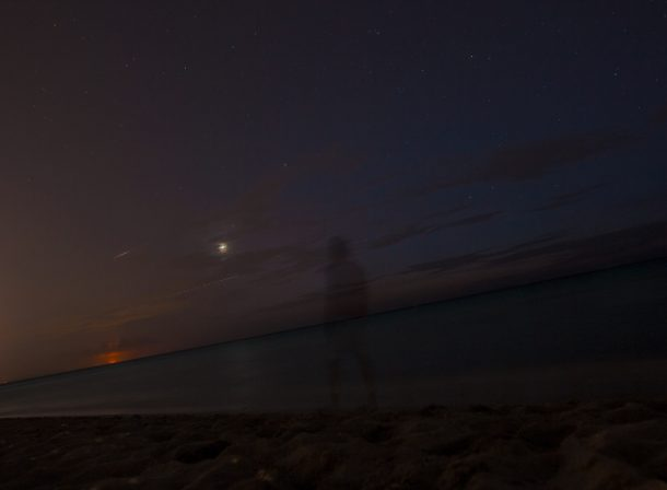 Long exposure self-portrait silhouette after sunset in Cuba. Travel photography.