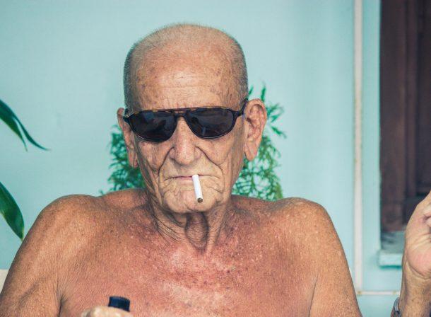 Cuba street photography of man smoking.
