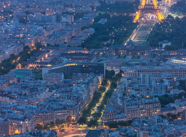 Aerial view of the Eiffel Tower in Paris, France, from Tour Montparnasse at blue hour.