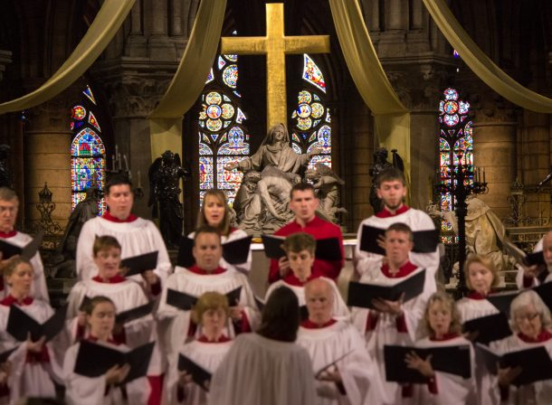 Travel photography. Choir singing in the Cathedral of Notre Dame in Paris, France.