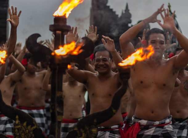 Travel photography. Men dancing with fire for the Kecak volcano dance in Ubud, Bali, Indonesia. Beautiful display of music, faith, and culture.