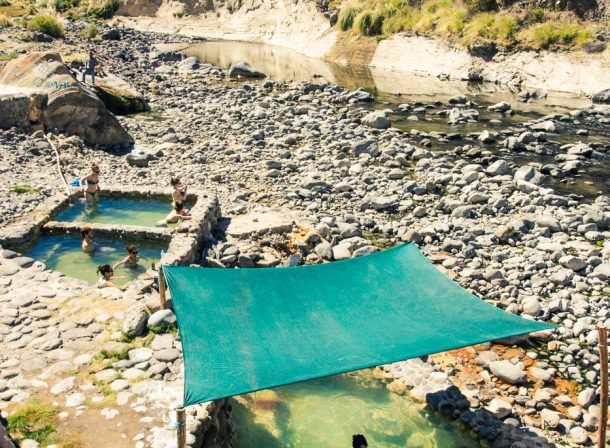 Travel landscape photography. Natural hot thermal bath springs in the bottom of Colca Canyon, Arequipa, Peru.