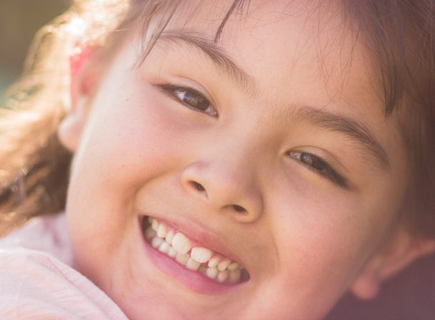 Young girl smiling into the camera, closeup.