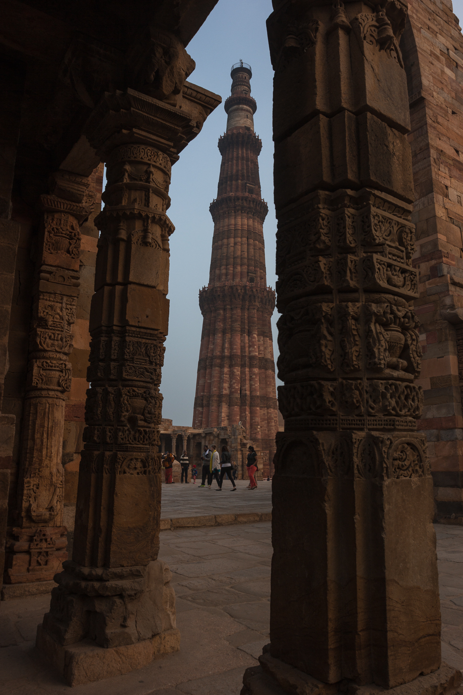 Vertical shot of the Qutb Minar in New Delhi, India. Travel architecture and historical photography.