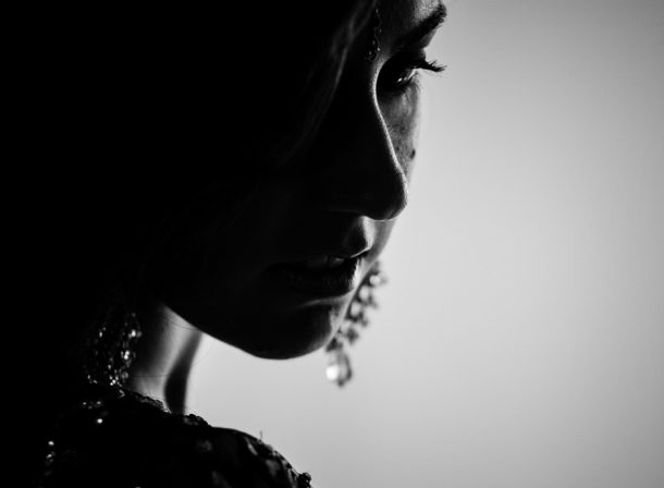 Silhouette of a girl wearing Indian clothing and jewelry. Lehnga.