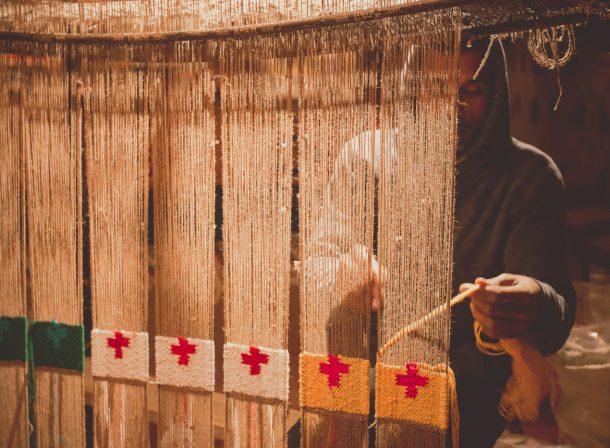 Young man weaving a quilt at Rangla Punjab, Jalandhar, India.