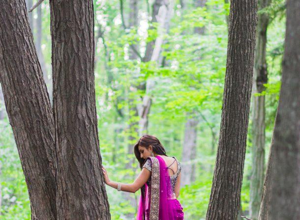 Girl wearing lehnga in woods.